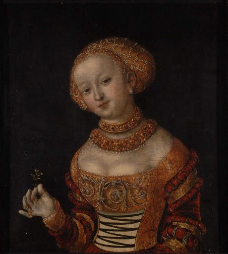 Porträt einer jungen Frau mit Blume