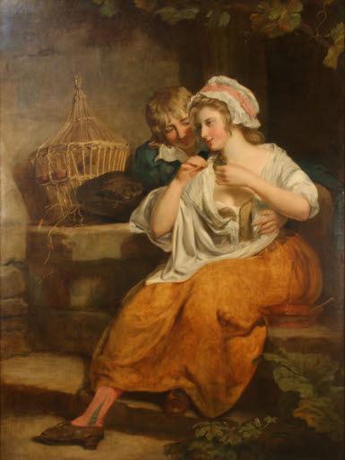 Junge Frau, einen Vogel fütternd