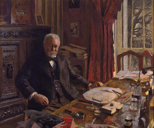 Porträt André Bénac in seinem Büro