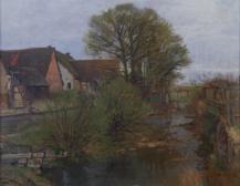 Bauernhäuser am steinigen Bach